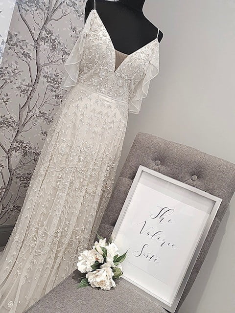 Private bridal suite with a white wedding dress on a stand in the middle